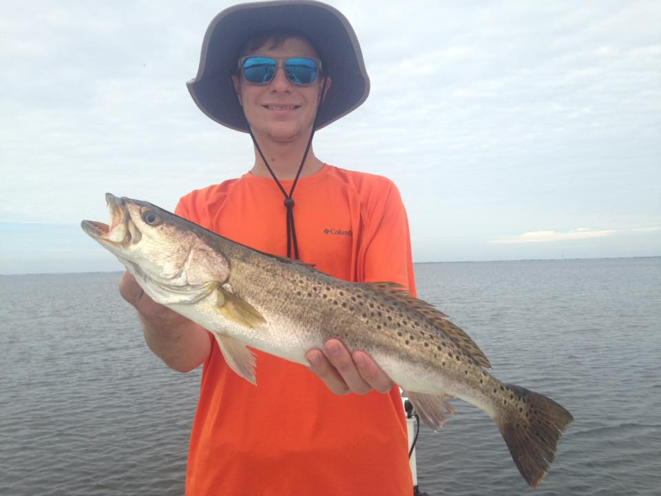 Three generations catching redfish today at cape san blas for Put in bay fishing charter