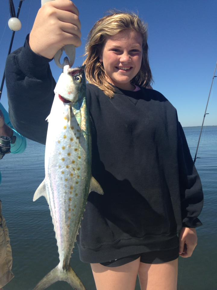 Teenage girls and dad catching redfish perfect cast for Cape san blas fishing